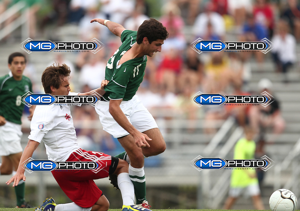 May 12, 2012; Huntsville, AL, USA;  John Carroll's Marc Gonzalez (17) is grabbed by Saint Paul defender. Mandatory Credit: Marvin Gentry