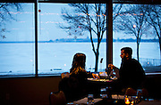 Diners look out over Lake Monona during the Friday Fish Fry at the East Side Club, Friday, February 5, 2016. The weekly event is now being managed by the owners of Slide Food Cart in their rebranded catering venture, Beyond Catering.