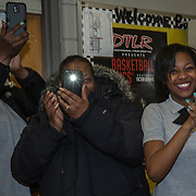 WASHINGTON,DC - MAR18: Family members of Lashae Hunter, a senior at Cesar Chavez Public Charter School for Public Policy, celebrate when Lashae was surprised at school with a hand-delivered acceptance letter and full scholarship to George Washington University, March 18, 2015, through the Stephen Joel Trachtenberg Scholarship program. (Photo by Evelyn Hockstein/For The Washington Post)