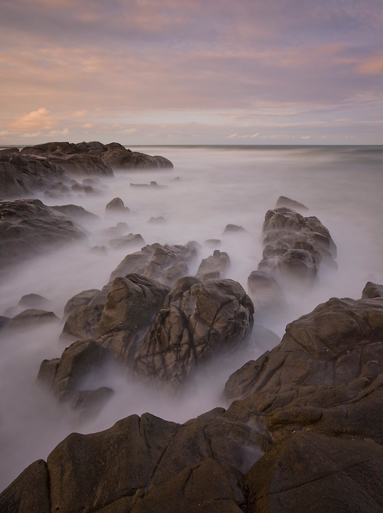 A fair amount of seaspray with a high tide and the odd surging swell made things difficult so I kept the shutter speed down to 30 sec and timed the exposure with the sets of waves.