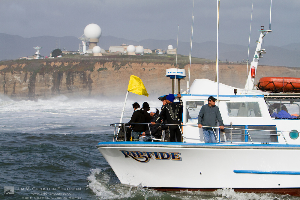 The 5 minute warning flag is placed on the judges boat during the final heat of the 2010 Mavericks Surf Contest held in Half Moon Bay, California on February 13, 2010