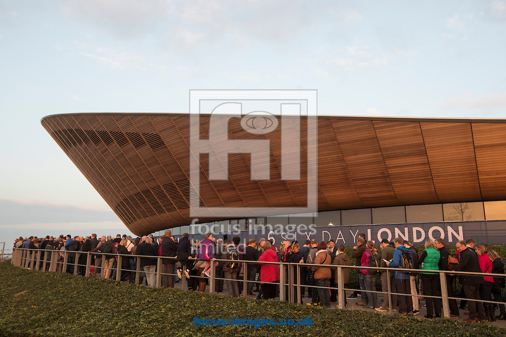 The sun sets over the Velodrome as fans queue to see Sir Bradley Wiggins and Mark Cavendish in action on day one of the Six Day cycling series at Lee Valley VeloPark, London, UK<br /> Picture by Ryan Dinham/Focus Images Ltd +44 7900 436859<br /> 25/10/2016
