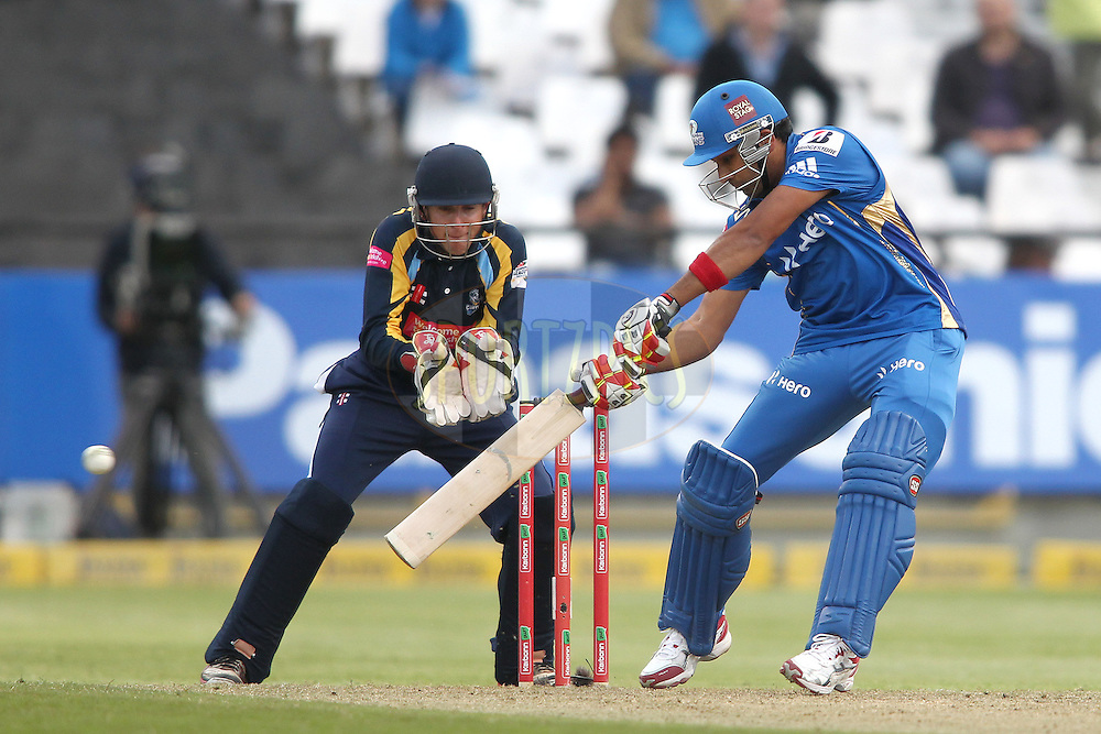 Rohit Sharma of the Mumbai Indians cuts a delivery square during match 11 of the Karbonn Smart CLT20 South Africa between The Mumbai Indians and Yorkshire held at Newlands Stadium in Cape Town, South Africa on the 18th October 2012..Photo by Shaun Roy/SPORTZPICS/CLT20