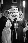 Nurses join other health workers for a NHS Day of Action torchlight vigil, York. 03-02-1988.