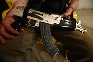 A member of a self-defense force shows off a silver-plated AK-47 he said was seized from the Knights Templar cartel as they fled town. The self-defense that have been armed only with shotguns and even slingshots said they are increasingly armed with bounty as the Knights Templar flee towns.