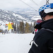 Guy in a chicken suit flapping his wings while getting air on gaper day at JHMR.