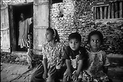 Maldive Islands<br />Children on their island home.<br />Note the walls made from coral and lime.<br />NB. Coca Cola is manufactured in the Maldives. All coke is made from sea water that is treated in a desalination plant. It is some of the best coke I have ever drunk!