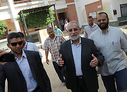 60371224 <br /> File photo taken on May 24, 2012 shows General Guide of Egypt's Muslim Brotherhood Mohamed Badie (C Front) at a polling station during the presidential election in Beni Suef, Egypt. Mohamed Badie was arrested by police in Cairo, official news agency MENA reported early Tuesday,  August 20, 2013 citing a security source. <br /> Picture by imago / i-Images<br /> UK ONLY