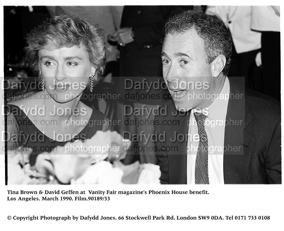 Tina Brown & David Geffen at  Vanity Fair magazine's Phoenix House benefit. Los Angeles. March 1990.<br />