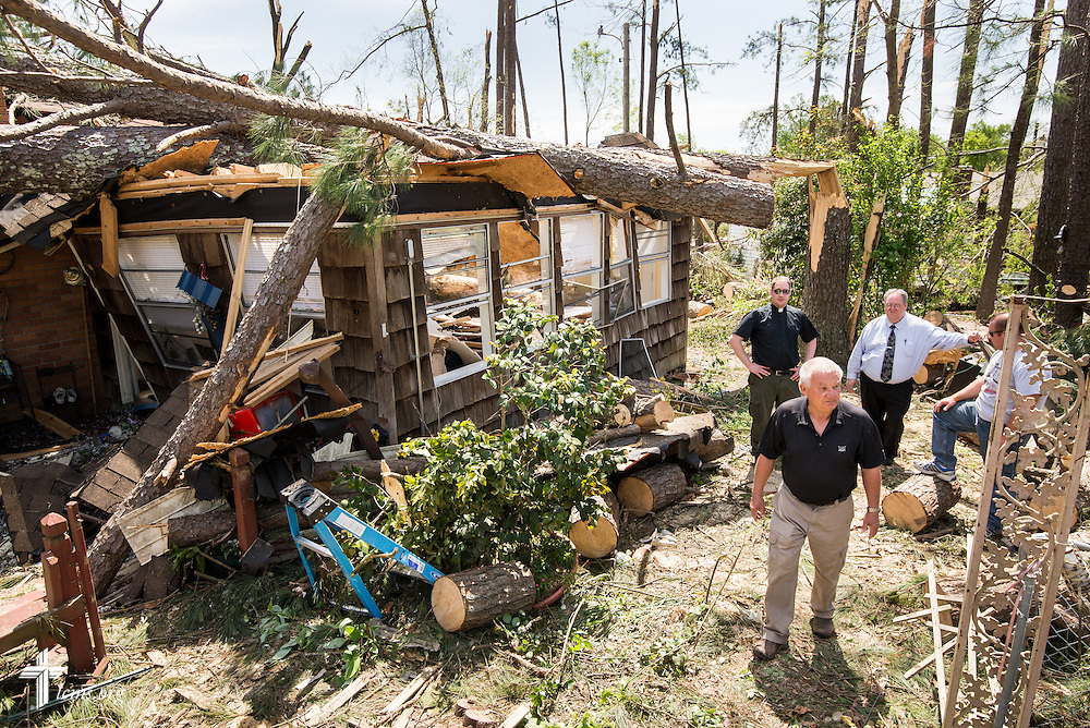Terry Dufford shows the Rev. Michael Meyer, manager of LCMS Disaster Response (rear, left) and the Rev. David  Mac Kain of Holy Trinity Lutheran Church (next to Meyer) the damage to their home in Tupelo, Miss., on Friday, May 2, 2014. A tornado ravaged the community earlier in the week. The Duffords are members of Holy Trinity Lutheran Church in Tupelo. LCMS Communications/Erik M. Lunsford
