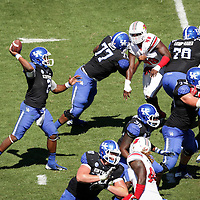 UK quarterback Jalen Whitlow throws a touchdown late in the fourth quarter as the University of Kentucky plays the University of Louisville at Commonwealth Stadium in Lexington, Ky. Saturday Sept. 14, 2013. Louisville beat Kentucky 27-13. Photo by David Stephenson