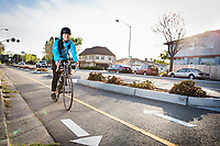 Nancy Z. (no last name given) rides her bike on the Fernside Blvd. bike lane near Otis Street in Alameda.