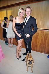 JENNI FALCONER and JAMES MIDGLEY and their dog Alfie at the annual Dog's Trust Honours Awards held at The Hurlingham Club, Fulham, London on 19th May 2009.