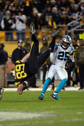Pittsburgh Steelers tight end Vance McDonald (89) is upended by Carolina Panthers strong safety Eric Reid (25) as he catches a third quarter pass for a gain of 19 yards to the Panthers 44 yard line during the NFL week 10 regular season football game against the Carolina Panthers on Thursday, Nov. 8, 2018 in Pittsburgh. The Steelers won the game 52-21. (©Paul Anthony Spinelli)