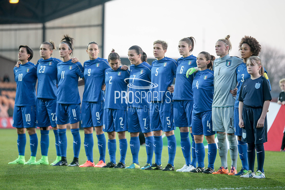 The Italy Ladies team during the national anthem before the Women's International Friendly match between England Ladies and Italy Women at Vale Park, Burslem, England on 7 April 2017. Photo by Mark P Doherty.