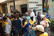 Crowds wait in 92 degree heat to visit the rectory home of the martyr Archbishop Oscar Romero. El Salvador prepares for the beatification ceremony and mass announcing the beatification of Archbishop Oscar Romero. The Archbishop was slain at the alter of his Church of the Divine Providence by a right wing gunman in 1980. Oscar Arnulfo Romero y Galdamez became the fourth Archbishop of San Salvador, succeeding Luis Chavez, and spoke out against poverty, social injustice, assassinations and torture. Romero was assassinated while offering Mass on March 24, 1980.