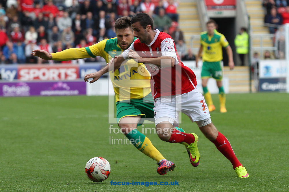 Gary Hooper of Norwich and Danny Lafferty of Rotherham United in action during the Sky Bet Championship match at the New York Stadium, Rotherham<br /> Picture by Paul Chesterton/Focus Images Ltd +44 7904 640267<br /> 25/04/2015