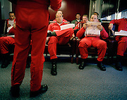 Squadron Leader Spike Jepson, leader of the elite 'Red Arrows', Britain's prestigious Royal Air Force aerobatic team, briefs his pilots in the briefing room at their RAF Scampton, Lincolnshire headquarters. Five autumn and winter months are spent teaching new recruits manual aerobatic display flying while the older members (who rotate positions) learn new disciplines within the routine. Their leaning curve is steep, even for these accomplished fast-jet aviators who had already accumulated 1,500 hours in fighters. By Summer they need every aspect of their 25-minute displays honed to perfection. In this meeting room they meet before and after every flight discussing safety, merits and failures.