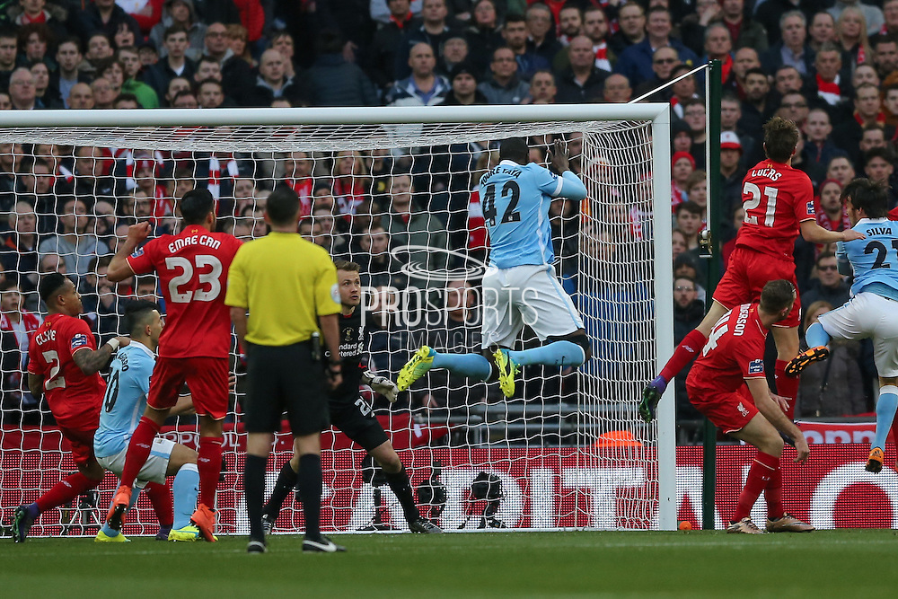 Manchester City midfielder Yaya Toure (42)  climbs for the ball during the Capital One Cup match between Liverpool and Manchester City at Anfield, Liverpool, England on 28 February 2016. Photo by Simon Davies.
