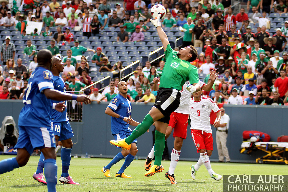 July 14 2013:  Martinique Goalie Kevin Olimpa (23) attempts to get his hand on the ball during the first half of the CONCACAF Gold Cup soccer match between Martinique and Mexico at Sports Authority Field in Denver, CO. USA.
