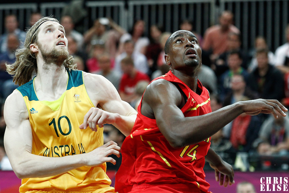 31 July 2012: Spain Serge Ibaka vies for the rebound with Australia David Barlow during the 82-70 Spain victory over Australia, during the men's basketball preliminary, at the Basketball Arena, in London, Great Britain.