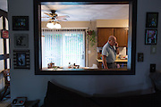 Ralph Paladino, 68, speaks on the phone at his home in Utica, NY on September 3, 2015. Ralph Paladino and his wife Rosemarie live primarily on Ralph's police officer's pension and social security, and have home equity loan with an interest rate linked to the prime lending rate. A Fed rate increase would force their already tight budget even further. Photographer: Mike Bradley/Bloomberg