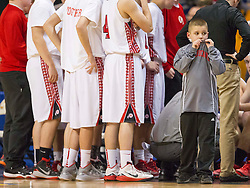 The Hurricane ball boy stands and watches the Huntington sideline during a timeout during a semi-final game at the Charleston Civic Center.