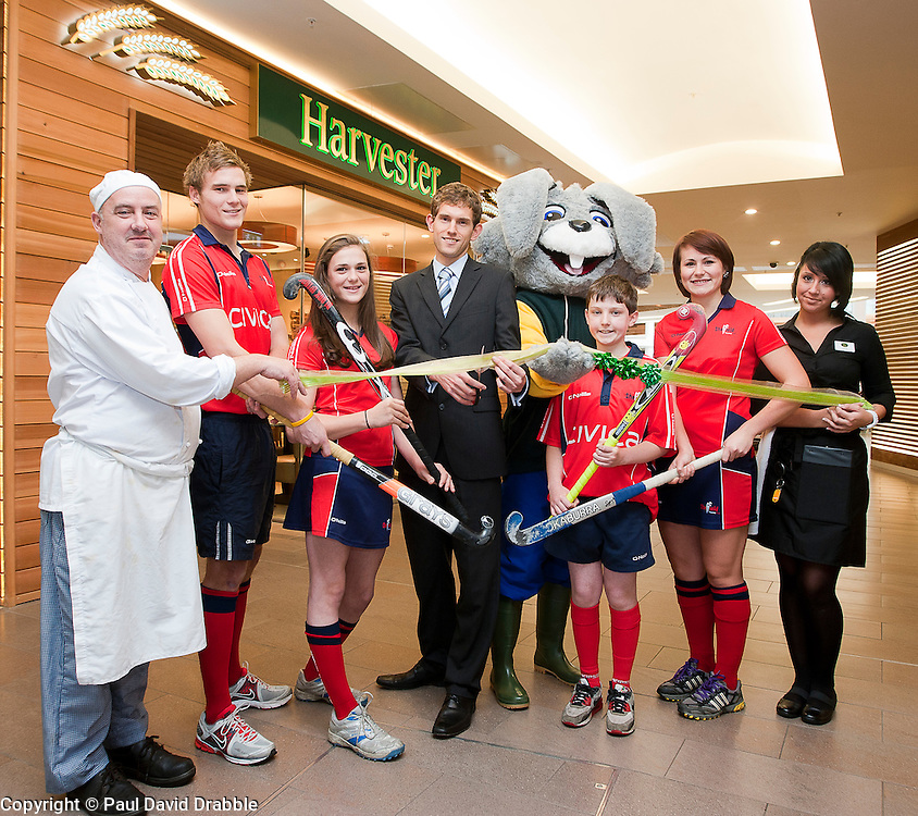 Official opening of Sheffield's new Harvester Salad & Grill at Meadowhall..Left to right Chef Neil Leech, England A team and Sheffield Hockey Clubs Martin Ebbage, Sheffield Hockey Club Junior Jemima Board with Mens 1st team Capatain and club Chairman Duncan Longson, Harvey The Rabbit, Sheffield Hockey Club players  Callum Groege and Ali Crewesmith, and Harvester staff Laura Goodall  .10 November 2011. Image © Paul David Drabble