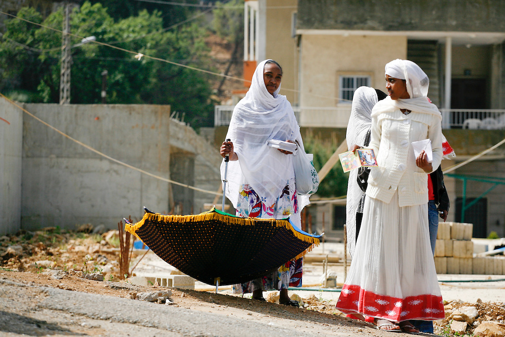 Ethiopian women collect donations from other workers outside their church on Easter Sunday.