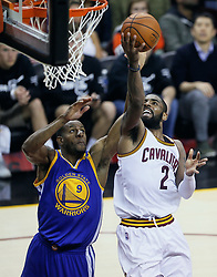 The Cleveland Cavaliers' Kyrie Irving puts up a shot against the Golden State Warriors' Andre Iguodala in the fourth quarter during Game 4 of the NBA Finals at Quicken Loans Arena in Cleveland on Friday, June 9, 2017. The Cavs won, 137-116, trimming their series deficit to 3-1. (Photo by Leah Klafczynski/Akron Beacon Journal/TNS) *** Please Use Credit from Credit Field ***