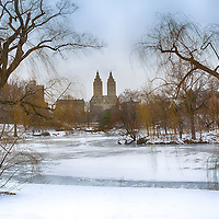 A frozen Central Park Lake in winter, New York