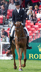 Mark Todd (NZL) and Major Milestone compete in the dressage test during the first day of the 2013 Mitsubishi Motors Badminton Horse Trials.  Friday 03  May  2013.  Badminton, Gloucs, UK..Photo by: Mark Chappell/i-Images