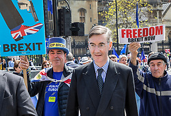 © Licensed to London News Pictures. 15/05/2019. London, UK. Conservative MP Jacob Rees Mogg (C) is surrounded by protestors as he leaves Parliament after attending Prime Minister's Question's. Photo credit: Peter Macdiarmid/LNP