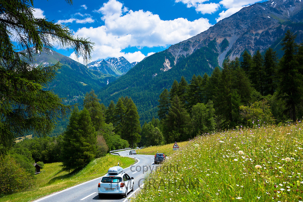 Cars on touring holiday in the Swiss Alps, Swiss National Park, Switzerland