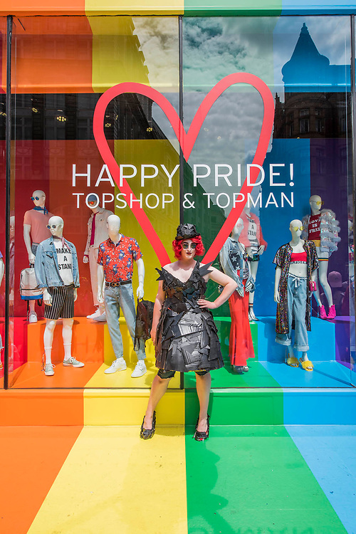 Posing in front of the Happy OPride rainbow Top Shop - The annual London Gay Pride march heads from Oxford Circus to Trafalgar Square.