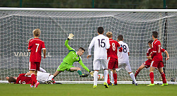 NEWPORT, WALES - Thursday, September 25, 2014: France's Calvin Tshilumba scores the first goal against Wales during the Under-16's International Friendly match at Dragon Park. (Pic by David Rawcliffe/Propaganda)