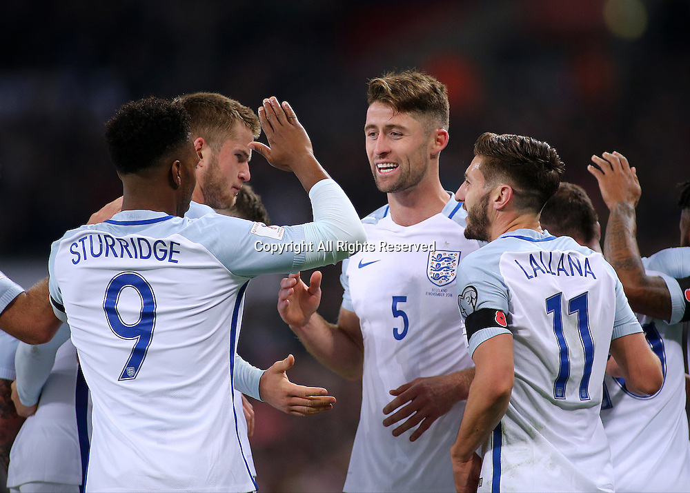 11.11.2016. Wembley Stadium, London, England. World Cup Qualifying Football. England versus Scotland. Gary Cahill celebrates with Adam Lallana and Daniel Sturridge after heading past Scotland Keeper Craig Gordon making it 3-0