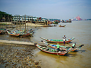20 NOVEMBER 2017 - YANGON, MYANMAR: River taxis wait for passengers in Dala. Tens of thousands of commuters ride the ferry every day. It brings workers into Yangon from Dala, a working class community across the river from Yangon. A bridge is being built across the river, downstream from the ferry to make it easier for commuters to get into the city.     PHOTO BY JACK KURTZ
