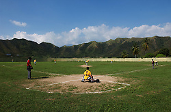 Students at the Venezuelan Air Force School play in a baseball tournament.  In a continent where soccer reigns supreme, baseball is the national sport in Venezuela.  There are scores of Venezuelans playing in the MBL and many American coahces and players  spend the off season in Venezuela's winter league.