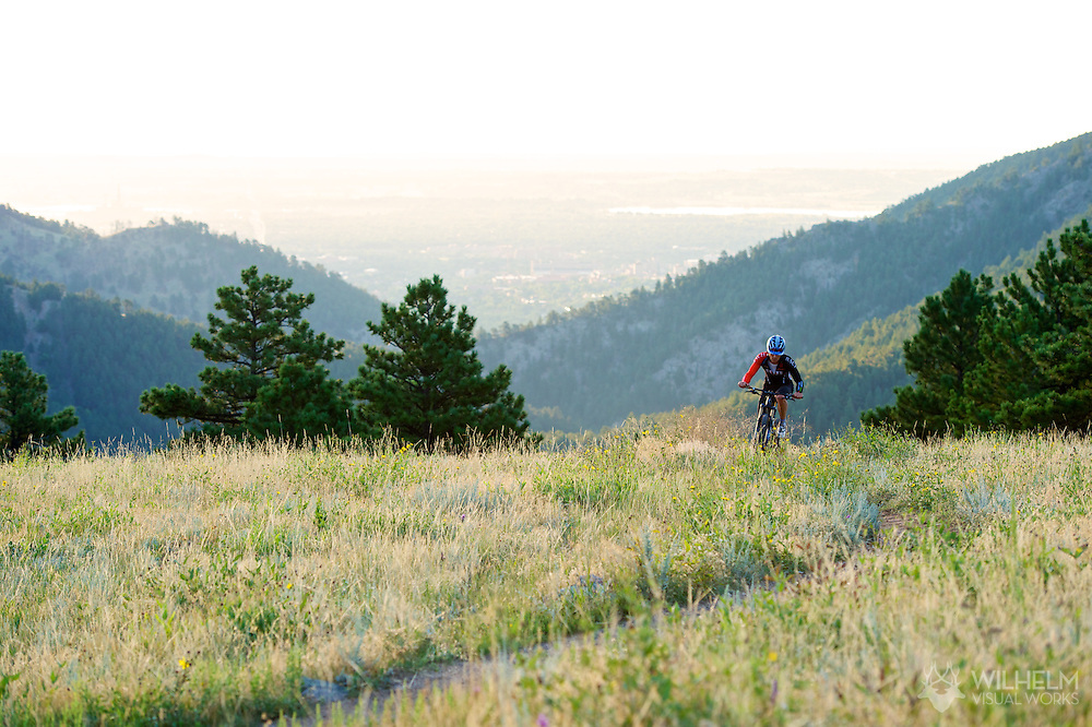 Jason Riley of Boulder mountain bikes the Betasso Link Trail during the sunrise hours at Betasso Preserve just above the town of Boulder, CO. © Brett Wilhelm