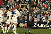 EDF Energy Cup, left Sharks, Lee THOMAS shakes hands with Quins Adrian JARVIS, who'd just missed kicking a conversation, with the score at 27 to 28 in the dying second of the NEC Harlequins vs Sale Sharks match at the Stoop Stadium, Twickenham. 07/10/2006 . [Photo, Peter Spurrier/Intersport-images]..