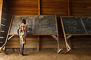 "A boy conjugates the verb ""to play"" on the blackboard during class at the Podio primary school in the village of Podio, Bas-Sassandra region, Cote d'Ivoire on Friday March 2, 2012."