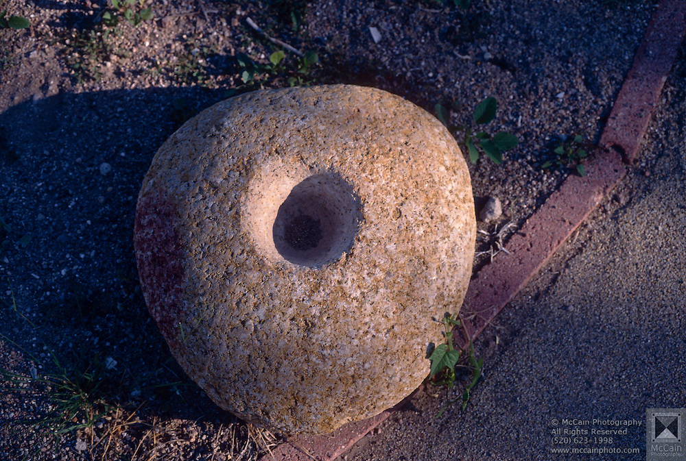 Old grain-grinding stones, Tumacacori Natl. Mon., Tumacacori, Arizona..Rights & Usage:.No rights granted. Subject photograph(s) are copyrighted by Edward McCain/McCain Photography. All rights are reserved except those specifically granted in writing prior to any use...McCain Photography.211 S 4th Avenue.Tucson, AZ 85701-2103.(520) 623-1998.mobile: (520) 990-0999.fax: (520) 623-1190.http://www.mccainphoto.com.edward@mccainphoto.com