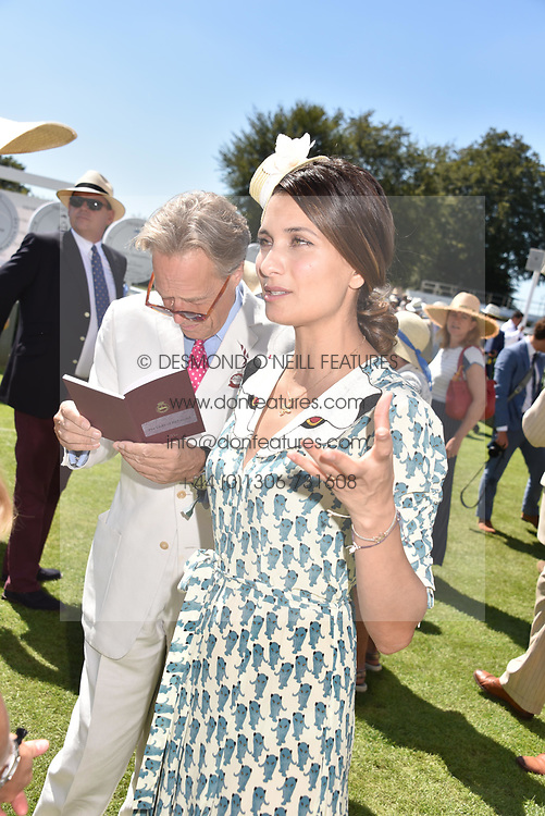 Left to right, the Duke of Richmond and designer Morvarid Sahafi at the Qatar Goodwood Festival - Glorious Goodwood, Goodwood Racecourse, West Sussex 02 August 2018.