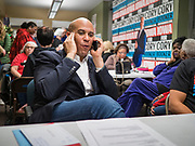 19 DECEMBER 2019 - URBANDALE, IOWA: US Senator CORY BOOKER (D-NJ) makes a phone call to a prospective caucus goer during a phone bank at his presidential campaign headquarters in Urbandale, a suburb of Des Moines. Sen. Booker, who did not qualify for the December 19 debate in Los Angeles, campaigned in the Des Moines area Thursday and visited the phone bank at his Iowa campaign headquarters. Iowa traditionally holds the first event of the presidential election cycle. The Iowa caucuses at Feb. 3, 2020.                PHOTO BY JACK KURTZ