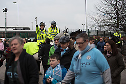 © Licensed to London News Pictures. 10/04/2018. Manchester, UK. Mounted police separate fans of Liverpool and Manchester City Football Clubs outside the Etihad Stadium ahead of the Manchester City vs Liverpool Champions League quarter final match at the Etihad Stadium. Police have upgraded their operation covering the match after the Manchester City coach was attacked with flares and bottles by Liverpool fans, outside Anfield last week. Photo credit: Joel Goodman/LNP