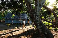 Child walks to school in the village of Lutes. Uleveo, Maskelyne Island, Malampa Province, Malekula, Vanuatu