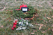 © Licensed to London News Pictures. 01/01/2013. Washington DC, USA . A bunch of roses lie next to an unmarked grave of Roger Wade Halford, I who was buried at Arlington on 20 November 2012. A head stone will be added.  Graves of US Soldiers killed in recent conflicts across the globe Arlington National Cemetery.  Photo credit : Stephen Simpson/LNP