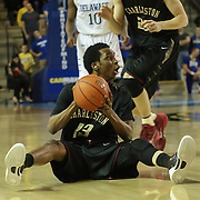 College of Charleston Guard Joe Chealey (13) dives for the loose ball in the first half of a NCAA regular season Colonial Athletic Association conference game between Delaware and The College of Charleston Wednesday, Feb 5, 2014 at The Bob Carpenter Sports Convocation Center in Newark Delaware.
