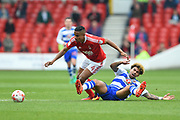 Nottingham Forest defender Michael Mancienne (4) tackles Reading midfielder Daniel Williams (23) during the EFL Sky Bet Championship match between Nottingham Forest and Reading at the City Ground, Nottingham, England on 22 April 2017. Photo by Jon Hobley.